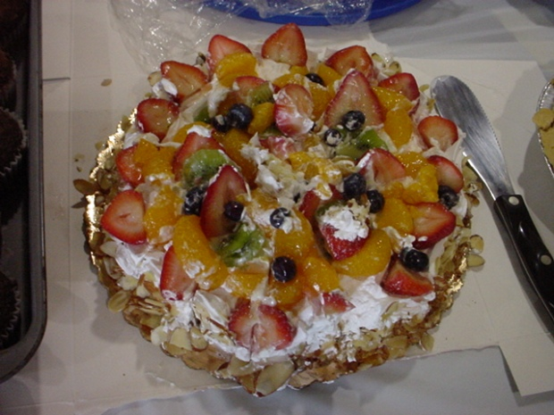 This looks like a fruit salad containing strawberries, blueberries, mandarin oranges, kiwis, slivered almonds, and whipped cream. It is actually rocks.