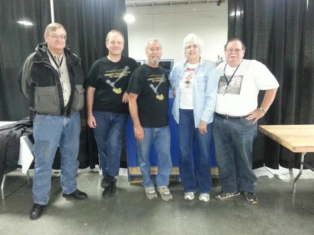 A group of 5 rock collectors who just finished packing up the show materials and cleaning up after the event ended.