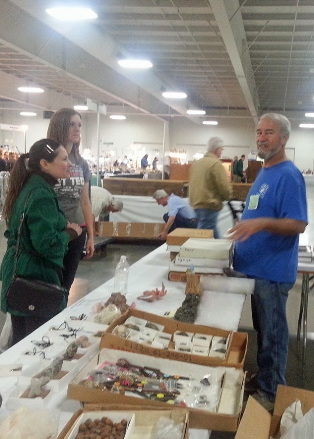 Bob selling minerals to some happy customers.