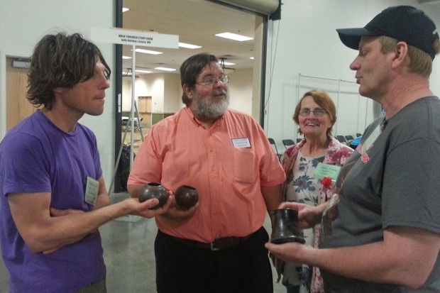 Four Show-Me Rockhounds members discussing pottery.