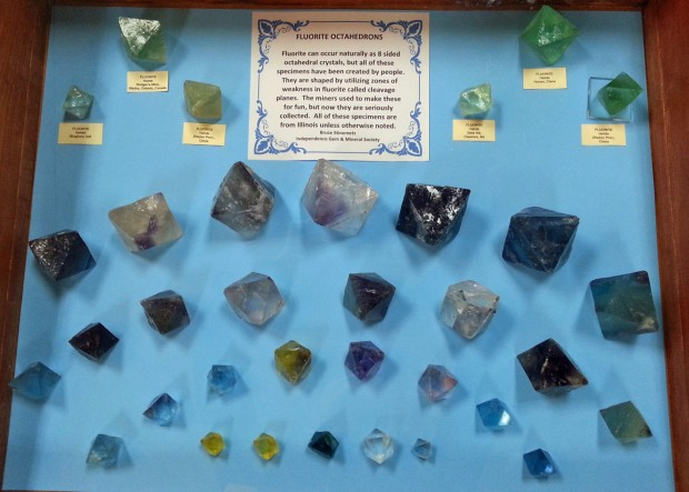 A display of fluorite octahedrons of many different colors and sizes.