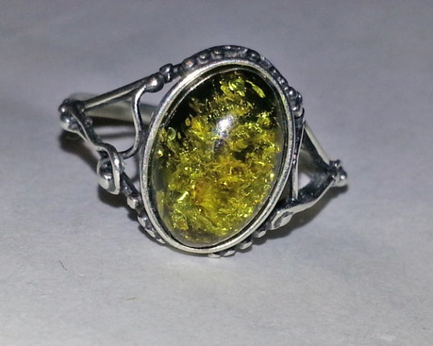 silver ring with oval green amber