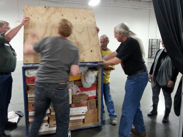 men packing items for storage